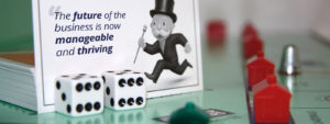 """two dice placed on the table with a frame of a running cartoon man and a text title """"Accounting and Cashflow Management"""" on the back"""