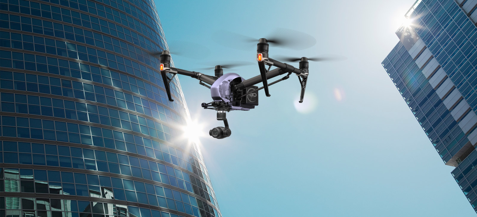 a flying drone on a modern city with high rise buildings
