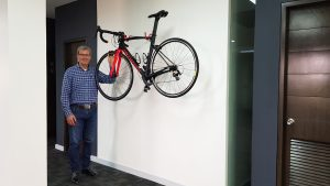 director of PBO Global outsourcing together his red road bike at Clark, Philippines