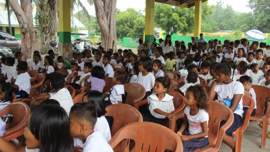 Aeta students gathered in a covered hall during a gift-giving CSR program