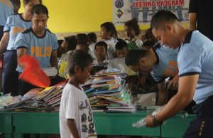 Aeta student receiving school supplies during the gift-giving CSR program of PBO Global and NAPCOS Capas
