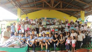Aeta students showing the school supplies given through a CSR activity
