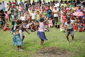 Aetas performing their traditional dance in front of their community
