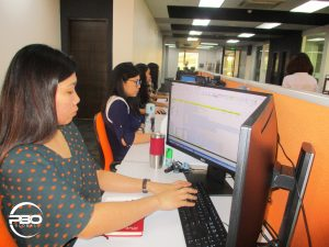 outsource accountants encoding entries at their work station