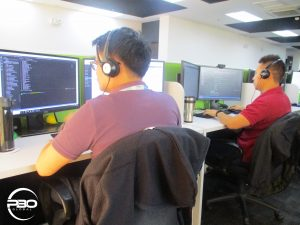 two male web developers encoding at their desk