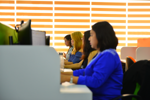 Australian outsourcing company staff encoding at their work station
